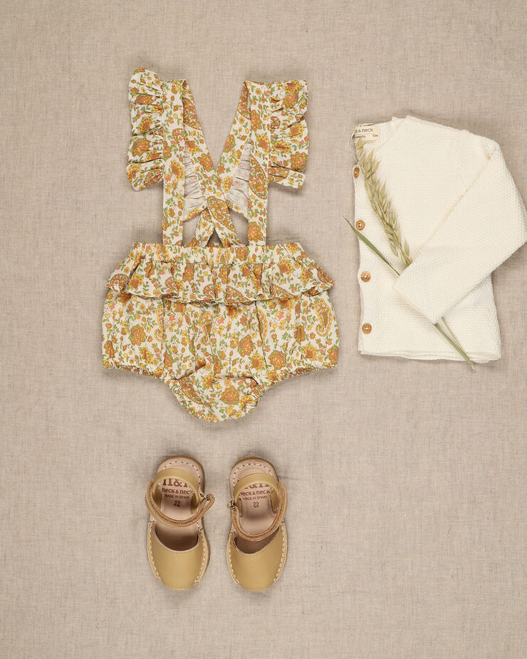 Yellow pasley print baby girl bloomer with frills details on suspenders.