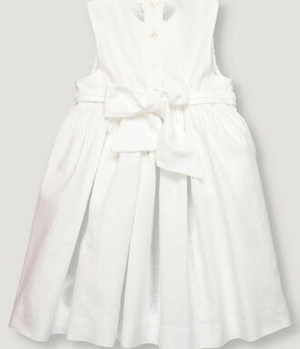 White smoke dress for girl with flower detail.