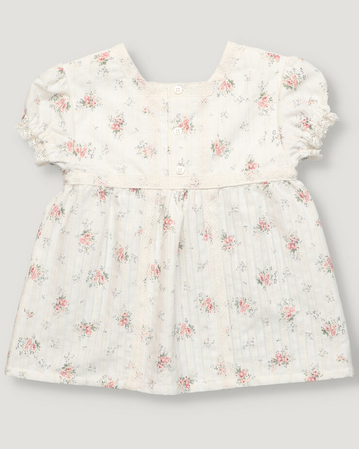 Light pink floral bouquet print baby girl blouse and cotton lace tape details.