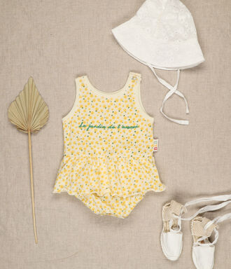 Yellow sunflower all over print baby girl knit romper with positional embroidery.