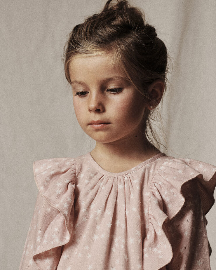 Light pink star pattern dress with ruffles in shoulders