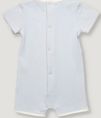 Light blue and off-white dots print baby unixes pajama, short sleeves with contrast piping for collar and hem. Back and crotch opening with snaps.