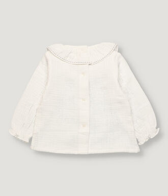 Off white baby blouse with grey stitching in collar