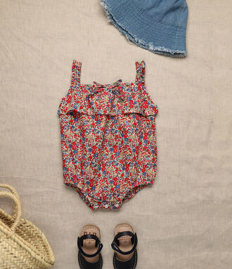 Liberty print baby girl romper in red and navy blue colors with frills details.